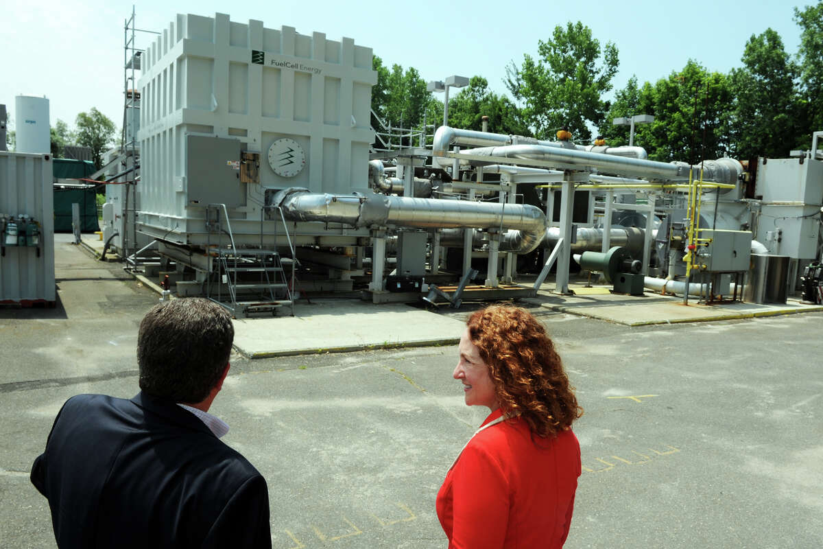 Anthony Rauseo, Senior Vice President and Chief Operating Officer for FuelCell Energy, leads U.S. Rep. Elizabeth Esty on a tour of the companyís facility in Danbury, Conn., July 2, 2014.