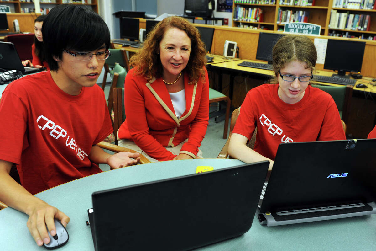 U.S. Rep. Elizabeth Esty sits with Kevin Dong and Emily Troll, two students in the CT Pre-Engineering Program (CPEP) summer design program at Danbury High School, in Danbury, Conn. July 2, 2014. CPEP students are spending the summer developing and designing mobile apps.