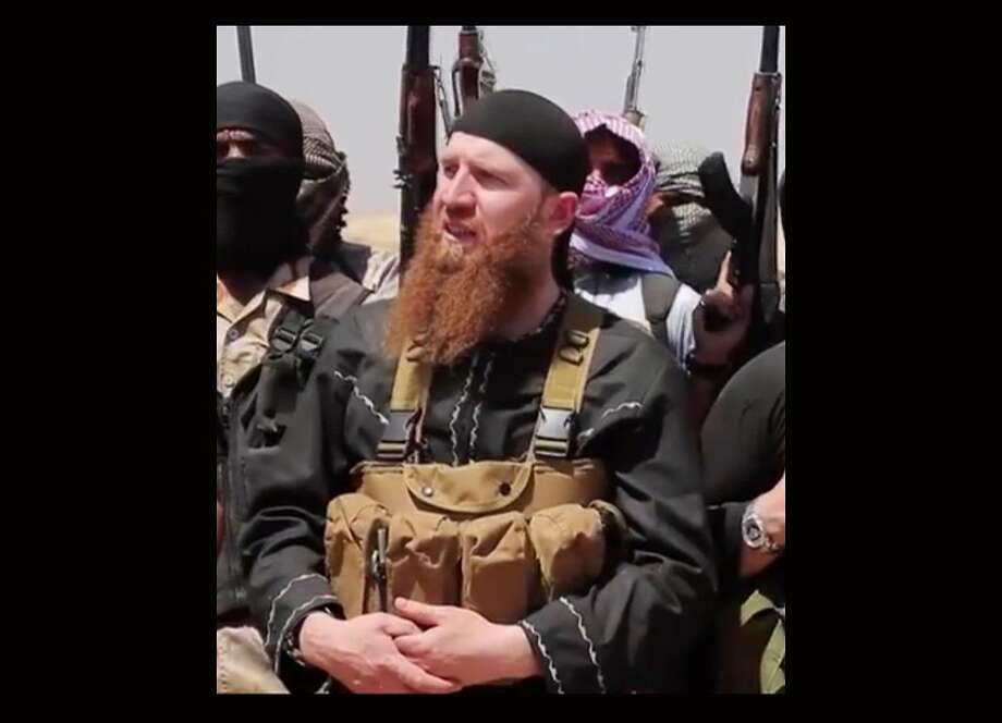 Omar al-Shishani stands among a group of fighters in Iraq. Photo: Associated Press