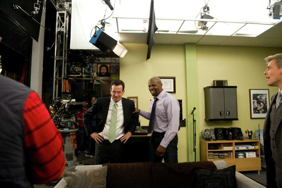"""Gov. Dan Malloy is shown during a tour of the Connecticut Film Center in Stamford in this file photo. Malloy's office on Wednesday announced that Disney-ABC Domestic Television has relocated its long-running show, """"Who Wants To Be A Millionaire,"""" from New York to Connecticut, which will create 150 new jobs in the state. Photo: Kathleen O'Rourke / Stamford Advocate"""