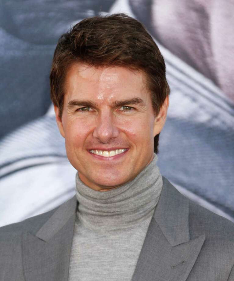 "Tom Cruise arrives at the LA premiere of ""Oblivion"" at the TCL Chinese Theater on Wednesday, April 10, 2013 in Los Angeles. (Photo by Todd Williamson/Invision/AP) Photo: Todd Williamson / Invision"