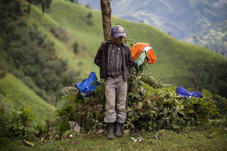 Gilberto Haroldo Ramos, 11, brother of Gilberto Ramos, stands in front of his remote home in the northern Cuchumatanes mountains of Guatemala. Photo: Luis Soto, Associated Press
