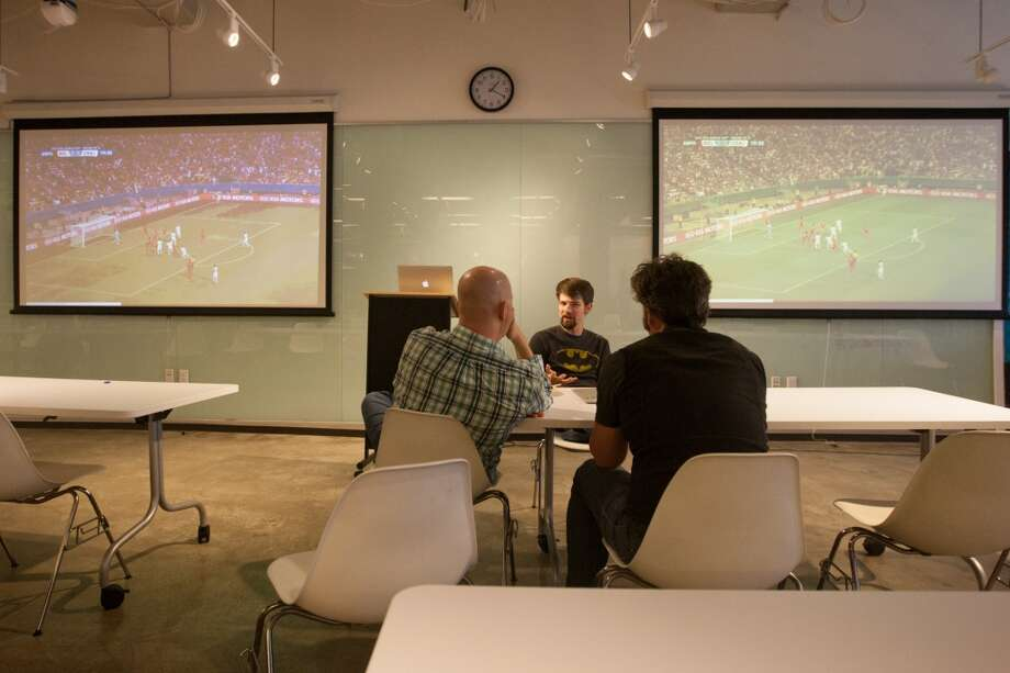But not everyone was watching the games, and talk about work continuted for some. Photo: Douglas Zimmerman, Courtesy