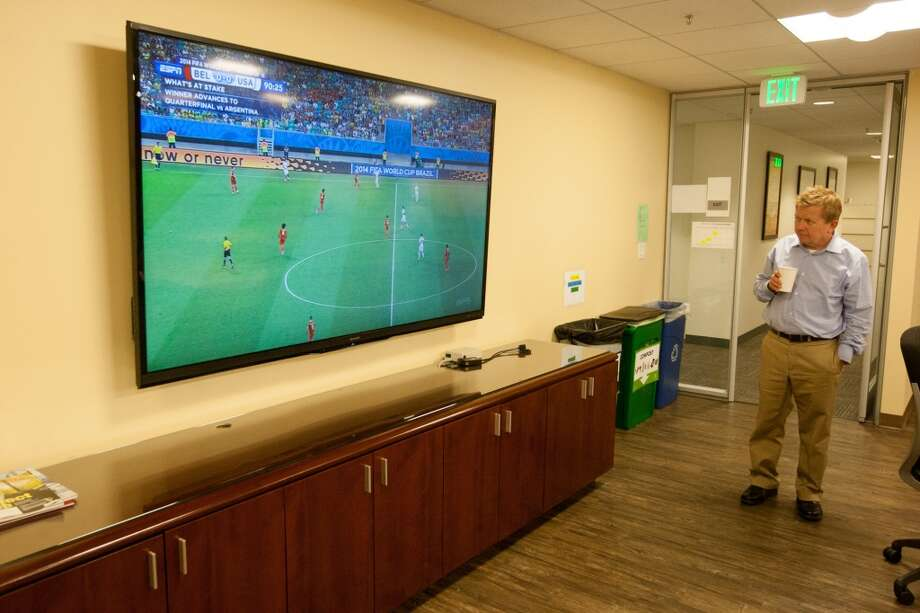 For the extra time period, a larger crowd gathered in the break room to watch the action. Photo: Douglas Zimmerman, Courtesy