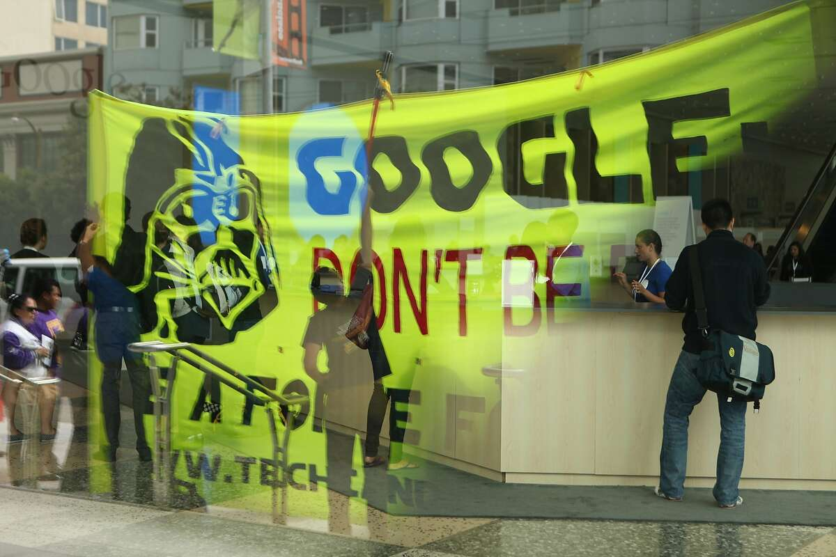 Several groups protest in front of Google I/O at Moscone Center in San Francisco Calif. as attendees check in on Wednesday, June 25, 2014.