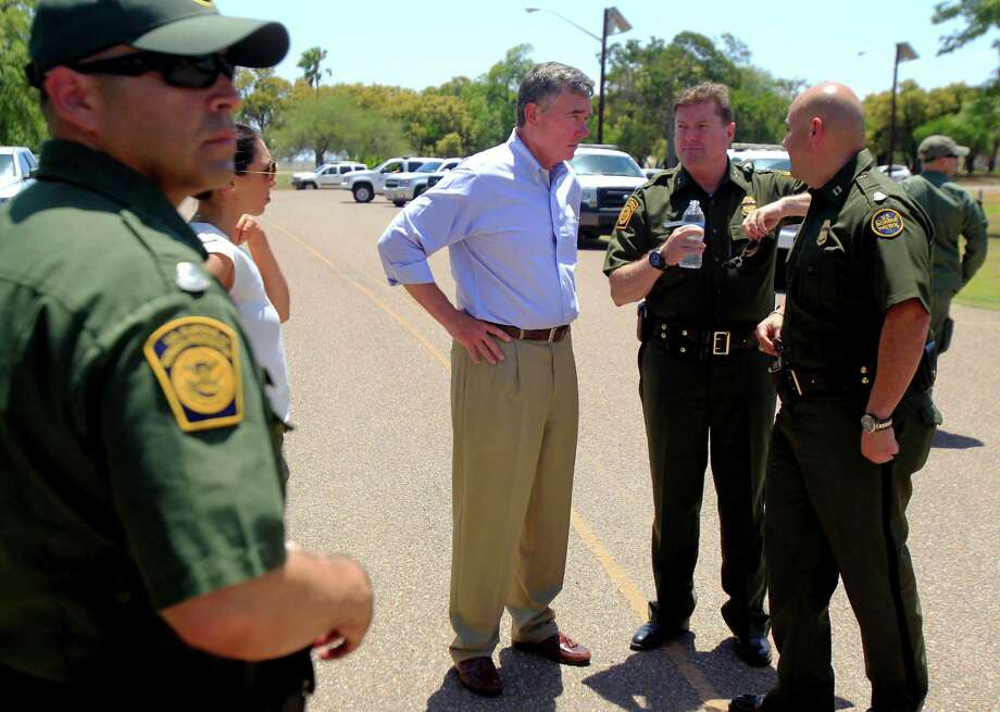 U.S. Customs and Border Protection Commissioner Gil Kerlikowske, center, talks to Rio Grande Valley Sector Chief Patrol Agent Kevin Oaks, right, after a news conference about the Dangers Awareness Campaign at Anzalduas Park next to the Rio Grande River in Mission, Texas on Wednesday July 2, 2014. The campaign is a Spanish-language outreach effort aimed at highlighting the risks and undercutting the perceived rewards of illegal immigration. (AP Photo/The Monitor, Gabe Hernandez) Photo: Gabe Hernandez, Associated Press / The Monitor