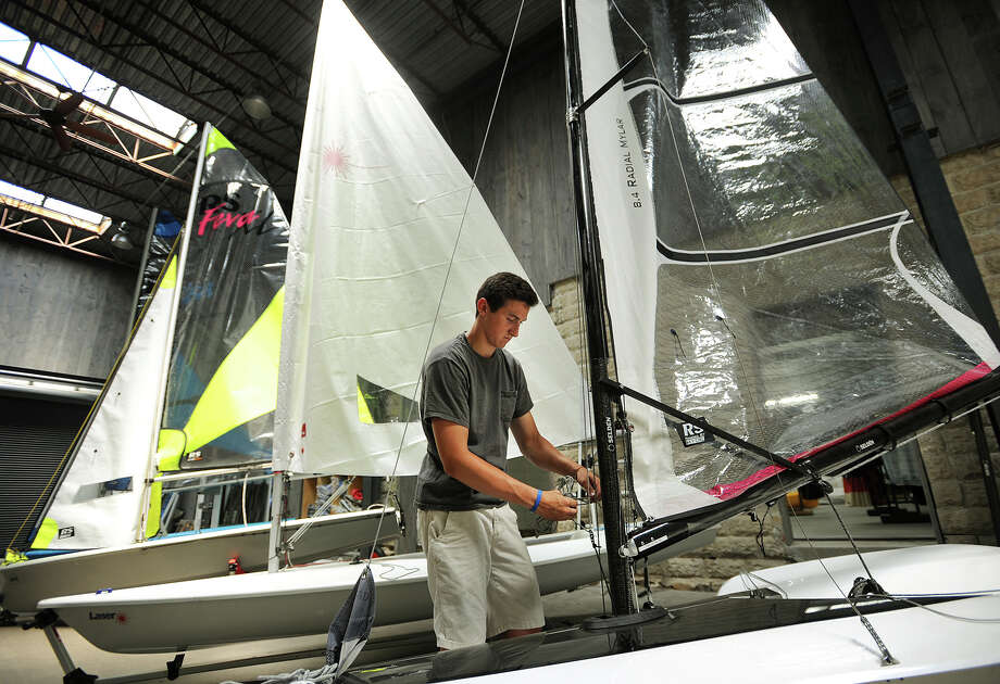 Employee James Manning rigs up a sailboat in the showroom of The Boat Locker's new location at 706 Howard Avenue in Bridgeport, Conn. on Wednesday, July 2, 2014. Photo: Brian A. Pounds / Connecticut Post