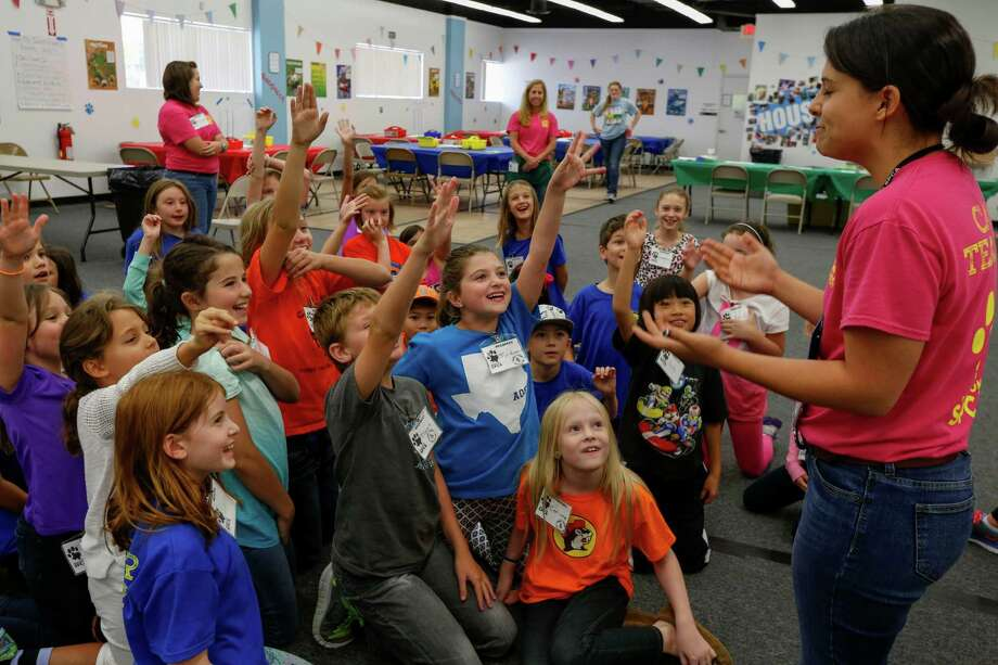 Third and fourth graders raise their hands to answer a riddle July 2, 2014 in Houston at Houston SPCA's summer critter camp. Photo: Eric Kayne, For The Chronicle / Eric Kayne