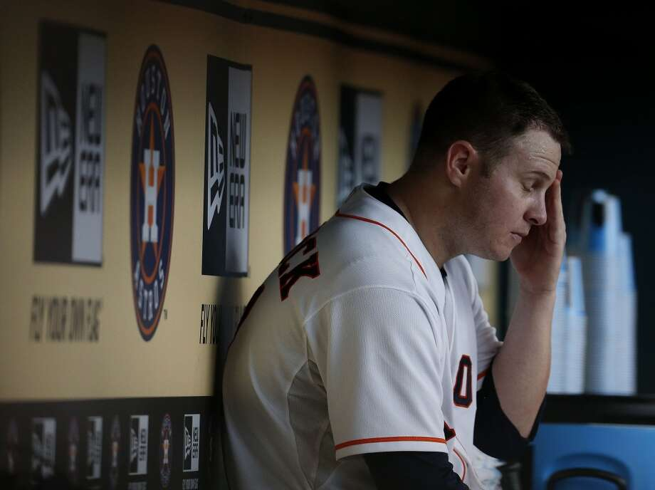 Astros starting pitcher Brad Peacock sits in the dugout after getting pulled in the sixth inning. Photo: Karen Warren, Houston Chronicle