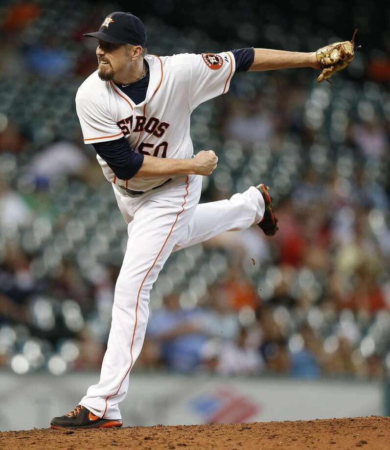 Astros relief pitcher Chad Qualls pitches during the ninth inning. Photo: Karen Warren, Houston Chronicle