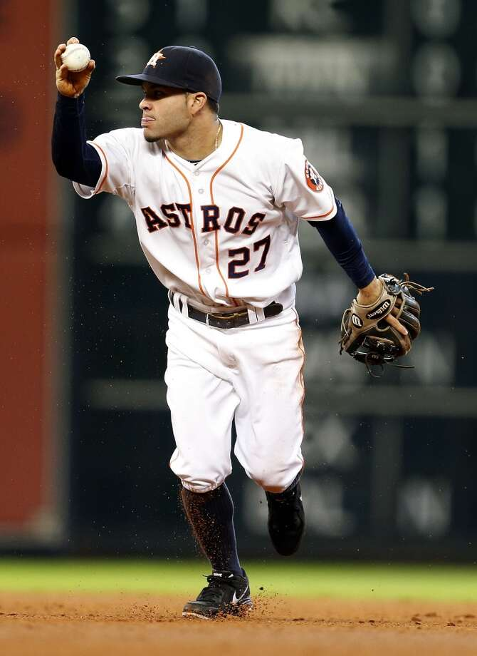 Astros second baseman Jose Altuve reacts after diving to tag out Mariners catcher John Buck at second base during the fourth inning. Photo: Karen Warren, Houston Chronicle