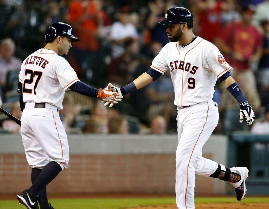 Astros shortstop Marwin Gonzalez (9) celebrates his home run with Jose Altuve (27) during the third inning. Photo: Karen Warren, Houston Chronicle