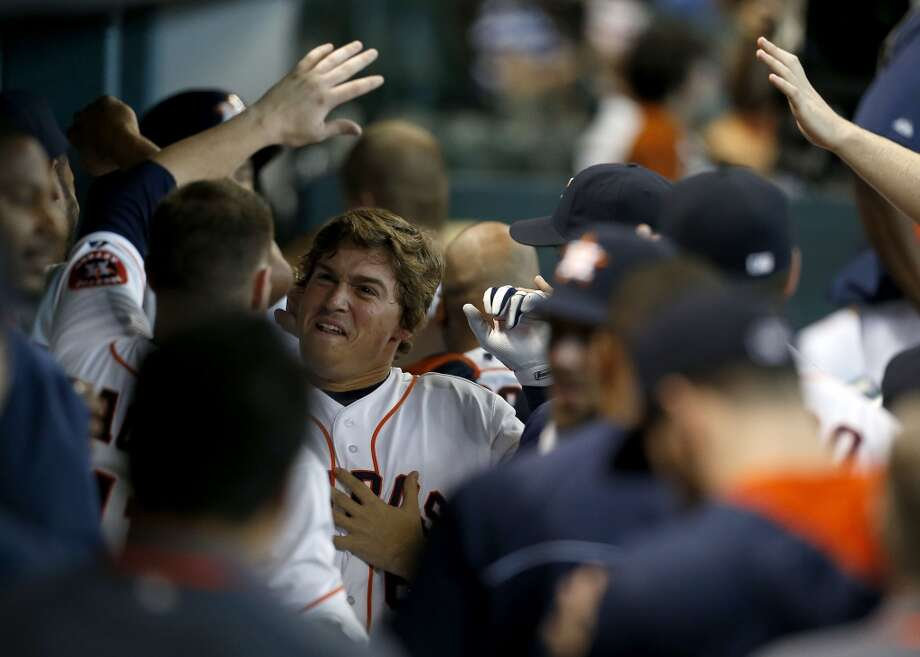 Astros infielder Kiké Hernandez (6) celebrates with teammates after hitting a solo home run during the fifth inning. Photo: Karen Warren, Houston Chronicle