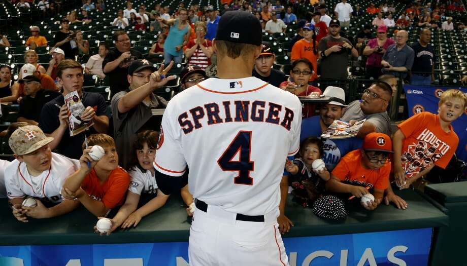 Astros right fielder George Springer signs autographs before the start of the game. Photo: Karen Warren, Houston Chronicle