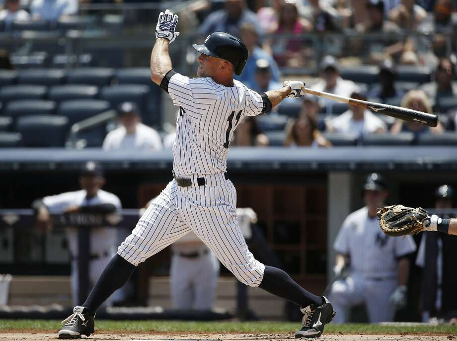 New York Yankees' Brett Gardner (11) hits a solo home run off Tampa Bay Rays starting pitcher Jake Odorizzi in a baseball game at Yankee Stadium in New York, Wednesday, July 2, 2014.  (AP Photo/Kathy Willens) Photo: Kathy Willens, Associated Press