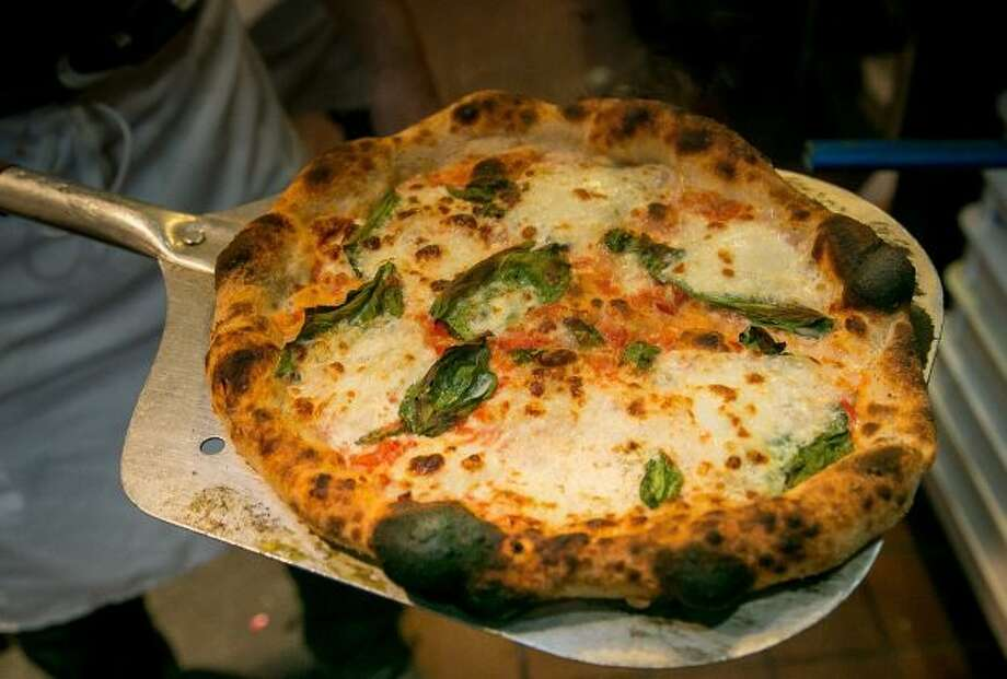 The Margherita pizza comes out of the oven at Pizza Hacker in San Francisco, Calif., on Thursday, March 20th, 2014. Photo: John Storey, Special To The Chronicle
