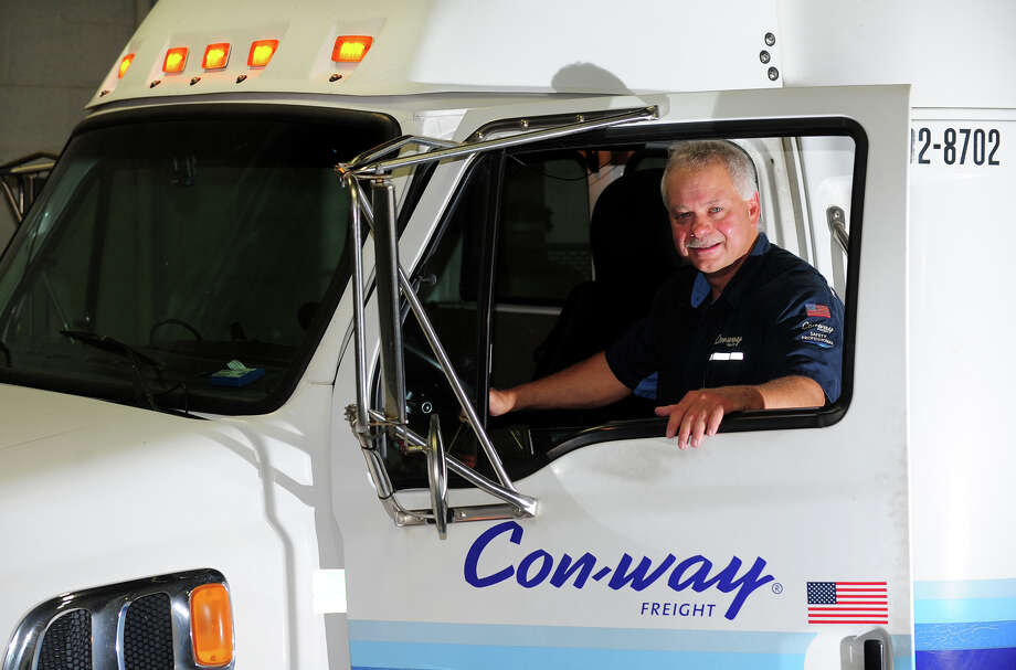 Ernie Budlowski poses with one of the Con-Way Freight tractor trailers at the trucking company he works for in Bridgeport, Conn. on Wednesday July 2, 2014. Budlowski has won first place in the straight truck division of the Connecticut State Truck Driving Championship. He goes on to compete in a national championship in August. Photo: Christian Abraham / Connecticut Post