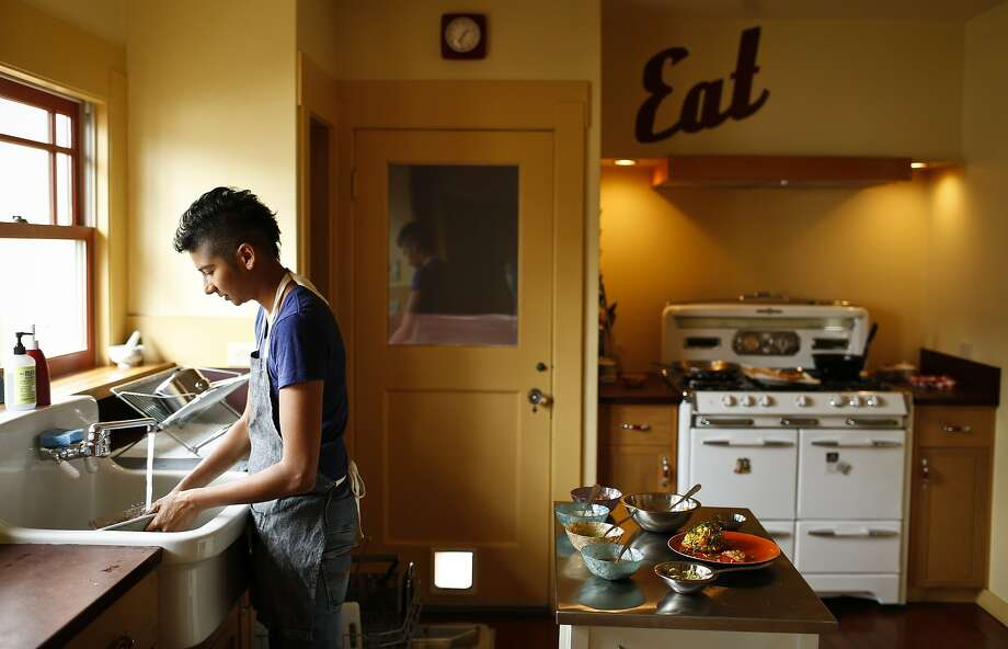 Preeti Mistry, owner of Oakland restaurant Juhu Beach Club, cleans up after cooking in her Oakland, Calif., home on Wednesday, June 25, 2014. Photo: Russell Yip, The Chronicle