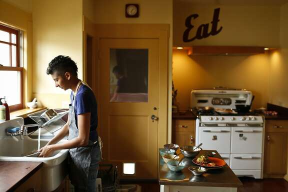 Preeti Mistry, owner of Oakland restaurant Juhu Beach Club, cleans up after cooking in her Oakland, Calif., home on Wednesday, June 25, 2014.