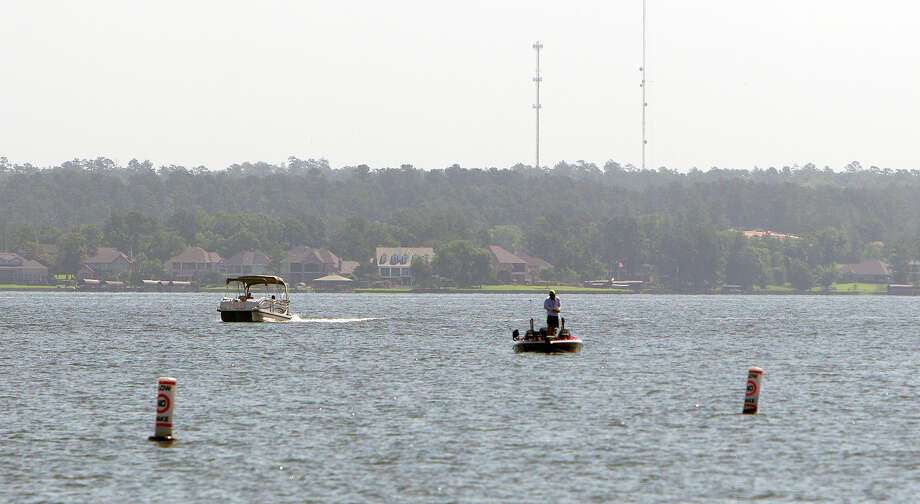 Boaters occupy the waters at Lake Conroe, Wednesday, July 2, 2014, in Conroe. Photo: Cody Duty, Houston Chronicle / © 2014 Houston Chronicle