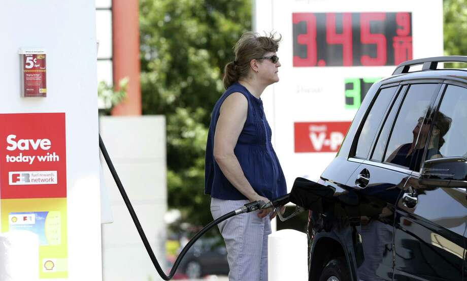 Motorists fuel up at the Shell station on Babcock and Wurzbach. AAA predicts 3 million Texans will travel 50 miles or more during the Independence Day holiday, an anticipated 2.9 percent increase over last year. Photo: Photos By Helen L. Montoya / San Antonio Express-News / SAN ANTONIO EXPRESS-NEWS