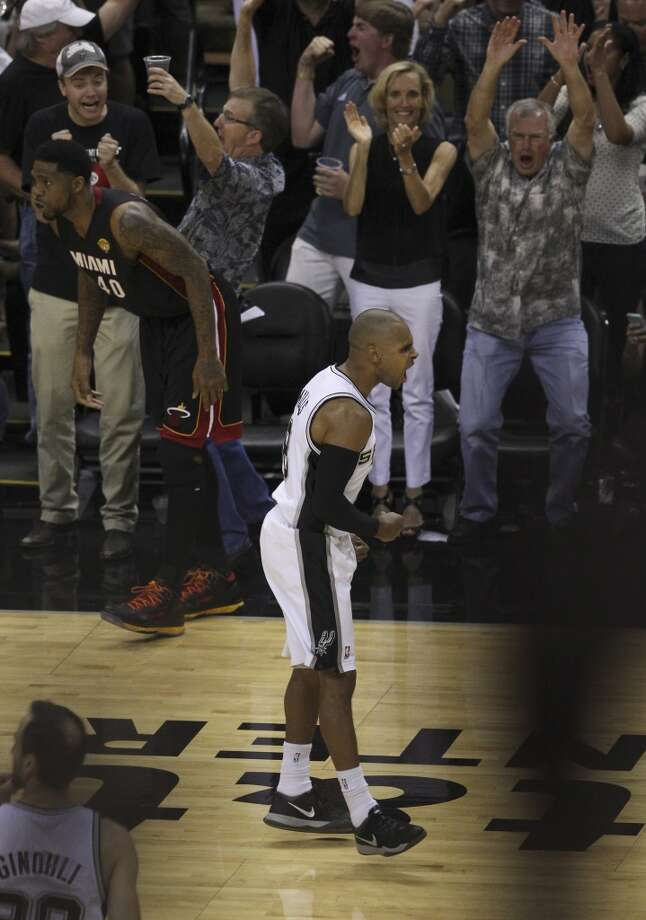 San Antonio Spurs' Patty Mills reacts after hitting a three pointer  against the Miami Heat in the second half of Game 5 of the 2014 NBA Finals at the AT&T Center on Sunday, June 15, 2014. (Kin Man Hui/San Antonio Express-News) Photo: San Antonio Express-News