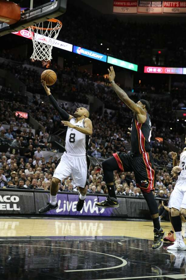 San Antonio Spurs' Patty Mills goes for the layup past Miami Heat's LeBron James during first half action in Game 5 of the 2014 NBA Finals Sunday June 15, 2014 at the AT&T Center. Photo: San Antonio Express-News