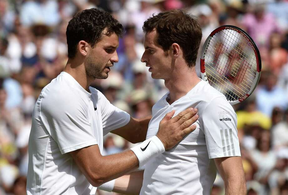 Grigor Dimitrov of Bulgaria, left, is congratulated by defending champion Andy Murray of Britain after winning their men's singles quarterfinal match at the All England Lawn Tennis Championships in Wimbledon, London, Wednesday July 2, 2014. (AP Photo/Toby Melville, Pool) ORG XMIT: WIM530 Photo: Toby Melville / Reuters Pool