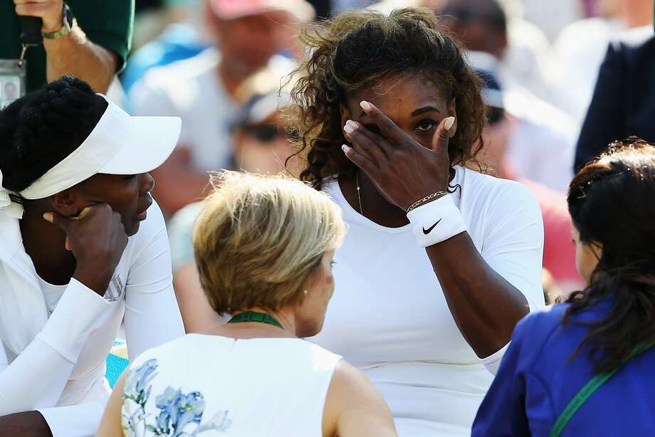 Serena Williams, above, receives treatment before Tuesday's doubles match, then later withdrew during a bizarre performance. On Saturday, below, the 17-time major singles champion showed negative body language. Photo: Jan Kruger, Getty Images