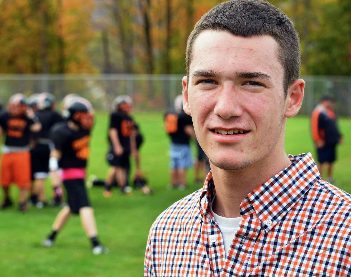 Blake Basmajian, a senior at Corinth and volunteer assistant coach at football practice Wednesday Oct. 16, 2013, in Corinth, NY. Basmajian was supposed to be the starting quarterback, but a head injury this summer made that impossible. (John Carl D'Annibale / Times Union)