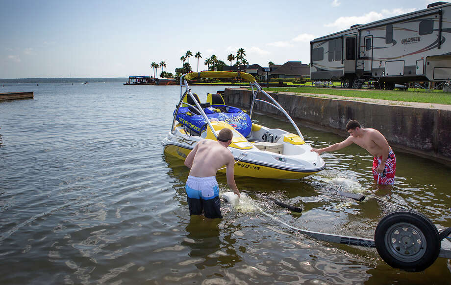 Jake Borsos, left, and Clayton Owen prepare Wednesday for an afternoon on Lake Conroe, which is expected to get very busy up to and throughout the upcoming July Fourth weekend. Photo: Cody Duty, Staff / © 2014 Houston Chronicle