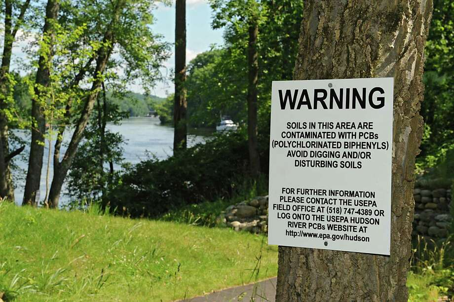 Signs are posted at the kayak launch at Hudson Crossing Park to warn boaters of potential exposure to polychlorinated biphenyls (PCB's) Friday, June 27, 2014 in Schuylerville, N.Y. The warning signs were results of soil samples taken last fall. (Lori Van Buren / Times Union) Photo: Lori Van Buren / 00027552A