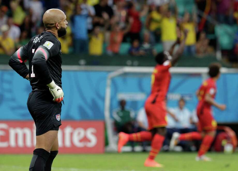 United States' goalkeeper Tim Howard reacts after Belgium's Romelu Lukaku scored his side's second goal during the World Cup round of 16 soccer match between Belgium and the USA at the Arena Fonte Nova in Salvador, Brazil, Tuesday, July 1, 2014.   (AP Photo/Julio Cortez) ORG XMIT: WCTH331 Photo: Julio Cortez / AP