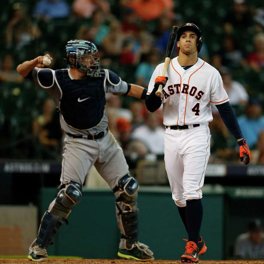 George Springer becomes the last of the Astros' 10 strikeout victims by whiffing in the ninth inning. Photo: Karen Warren, Staff / © 2014 Houston Chronicle
