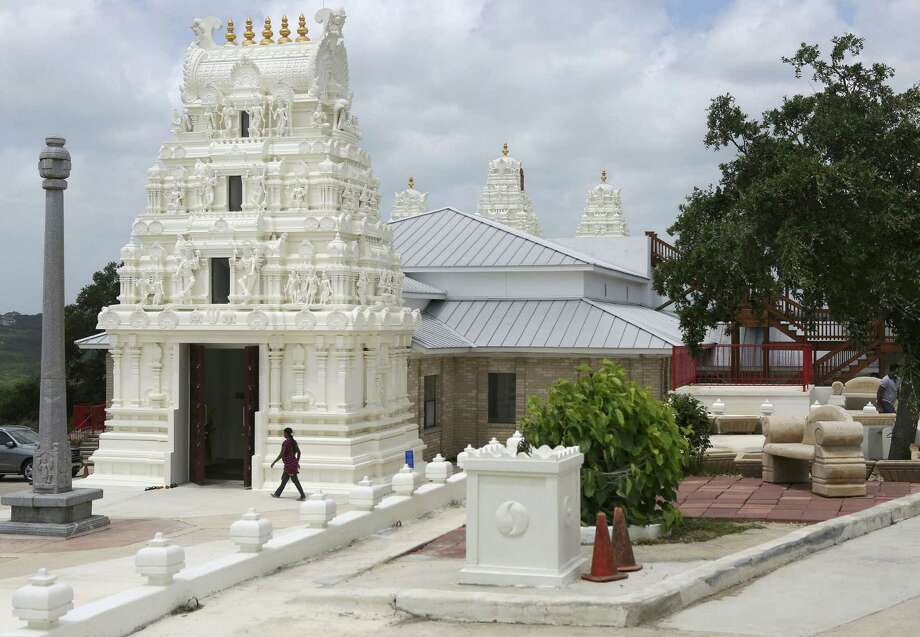 A woman walks into the Hindu Temple of San Antonio in Helotes after the morning service for puja, or ritual worship. The temple is open for Hindus to worship in throughout the week, as there is no designated weekly holy day in Hinduism. Photo: Photos By Timothy Tai / San Antonio Express-News / © 2014 San Antonio Express-News