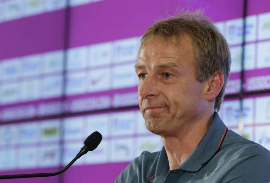 United States head coach Jurgen Klinsmann addresses the press in Sao Paulo, Brazil, Wednesday, July 2, 2014. The U.S. was eliminated from the second round of the 2014 soccer World Cup in a 2-1 loss to Belgium in Salvador, Brazil. (AP Photo/Julio Cortez) ORG XMIT: BRAJC102 Photo: Julio Cortez / AP