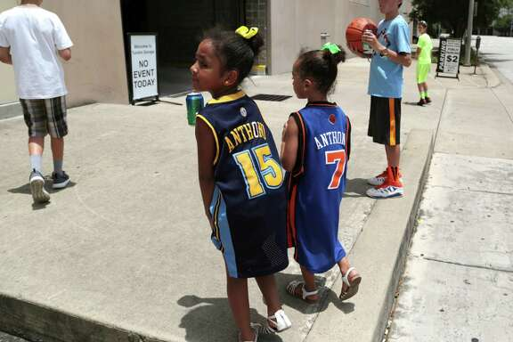 Sisters Alene, left, and Aliyah Contreras are such big fans of Carmelo Anthony that they were hoping to catch a glimpse of him Wednesday outside Toyota Center while decked out in their Nuggets and Knicks versions of his jersey.
