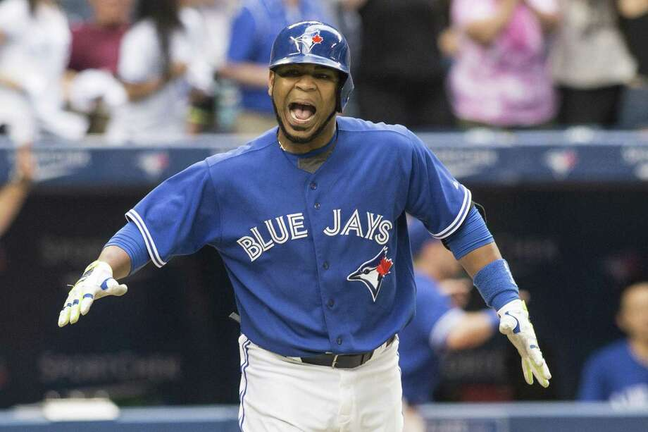 Toronto's Edwin Encarnacion exults after connecting on his game-winning homer against Milwaukee. Photo: Chris Young / Associated Press / The Canadian Press