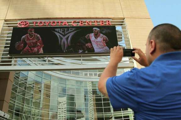 With camera aimed at Toyota Center's marquee, Rockets fan Frank Vasquez shoots what many hope comes to pass - forward Carmelo Anthony in a Rockets jersey.