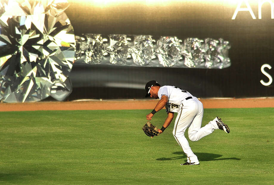 Centerfielder Reymond Fuentes of the San Antonio Missions makes a running catch during Texas League action against Tulsa at Wolff Stadium on Wednesday, July 2, 2014. Photo: Billy Calzada, San Antonio Express-News / San Antonio Express-News