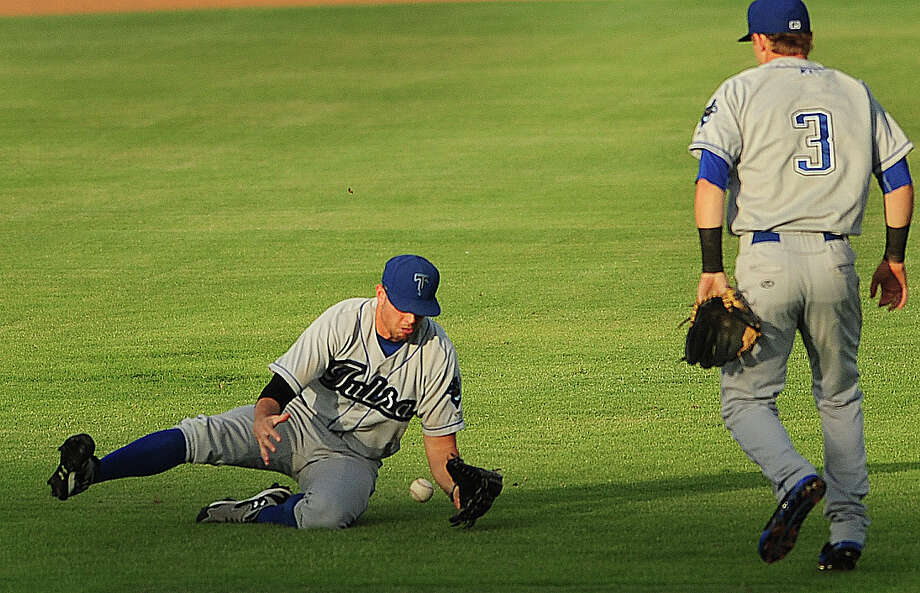 Tulsa Drillers left fielder Brian Humphries is unable to handle a pop fly as shortstop Trevor Story looks on. Humphries was able to recover and throw out San Antonio Missions runner Jason Hagerty. July 2, 2014. Photo: Billy Calzada, San Antonio Express-News / San Antonio Express-News