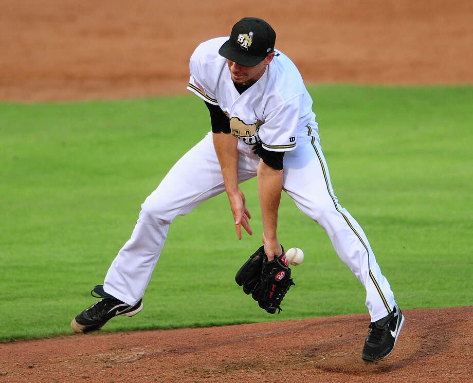San Antonio Missions pitcher John Geer is unable to handle a hard ground  ball hit back at him during Texas League action at Wolff Stadium on Wednesday, July 2, 2014. The play was ruled a hit. Photo: Billy Calzada, San Antonio Express-News / San Antonio Express-News