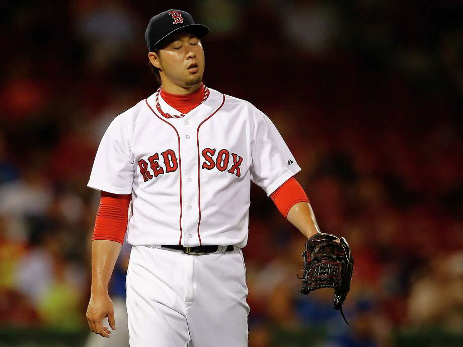 BOSTON, MA - JULY 2: Junichi Tazawa #36 of the Boston Red Sox reacts after pitching in the ninth inning against the Chicago Cubs at Fenway Park on July 2, 2014 in Boston, Massachusetts.  (Photo by Jim Rogash/Getty Images) ORG XMIT: 477585913 Photo: Jim Rogash / 2014 Getty Images
