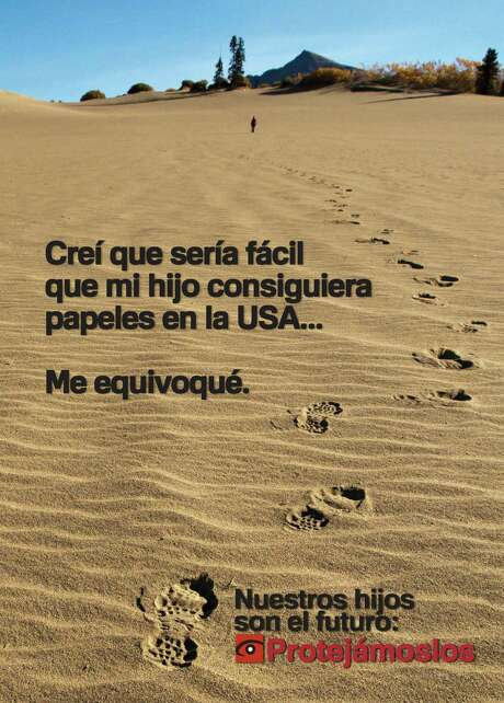 """""""I thought it would be easy for my child to get papers in the U.S.A. I was wrong,"""" this poster says. """"Our children are the future. Let's protect them."""" Photo: CBP Photo"""