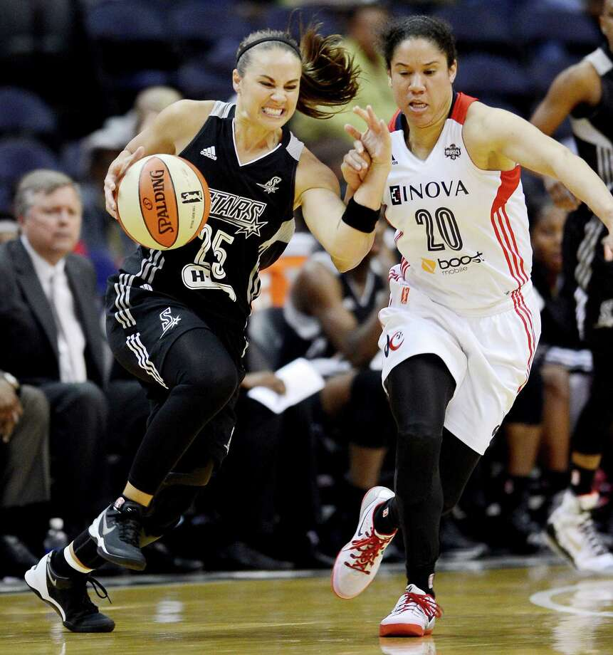 Veteran guard Becky Hammon (left), driving against Washington's Kara Lawson in a 73-65 victory Sunday, has missed just two games this season because of injury after sitting out all but one during 2013. Photo: Chuck Myers, McClatchy-Tribune News Service / MCT