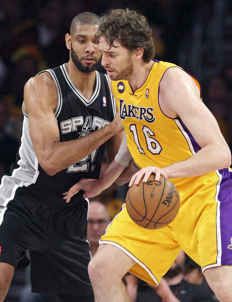 Tim Duncan and Pau Gasol as teammates? It's possible, but the free agent big man from Spain may want more money than what the Spurs can offer. Photo: Edward A. Ornelas, San Antonio Express-News / © 2013 San Antonio Express-News