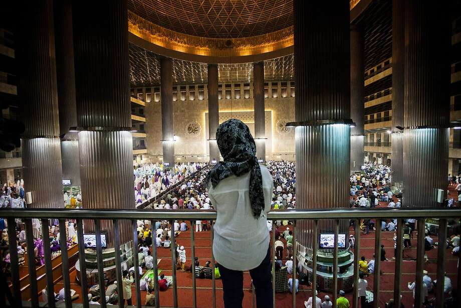 Indonesian Muslim women stand waiting for prayers to begin at Istiqlal Mosque in Jakarta. Photo: Oscar Siagian, Getty Images