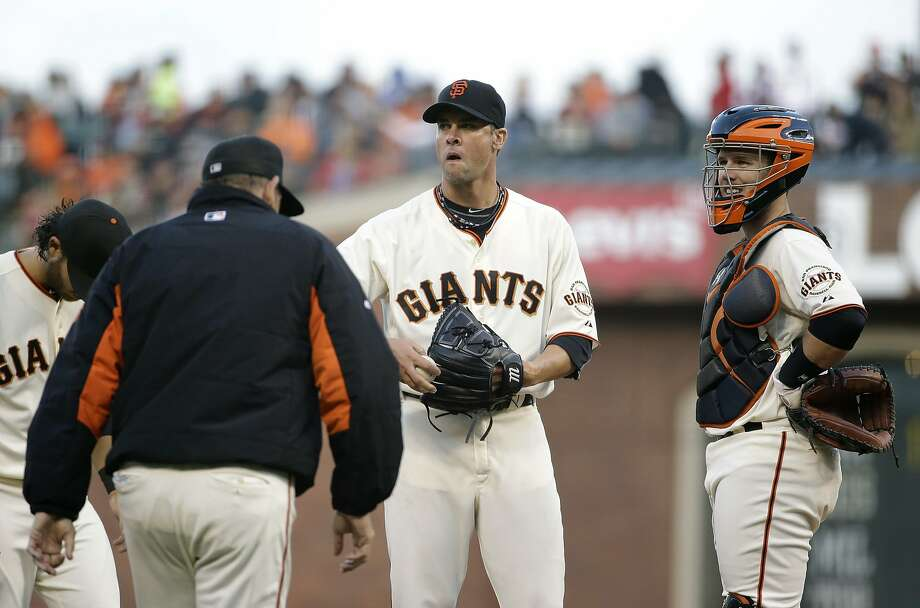 Giants starter Ryan Vogelsong meets with pitching coach Dave Righetti and catcher Buster Posey in the third inning, when St. Louis scored twice. Photo: Eric Risberg, Associated Press
