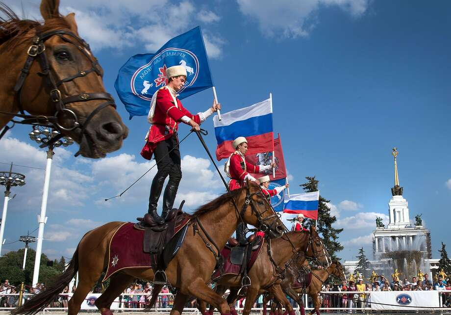 Wearing costumes of Kuban Cossacks horsemen of the Kremlin Riding School perform at the VDNKh, a public park and exhibition space, in Moscow, on July 1, 2014. AFP PHOTO / ALEXANDER UTKINALEXANDER UTKIN/AFP/Getty Images Photo: Alexander Utkin, AFP/Getty Images