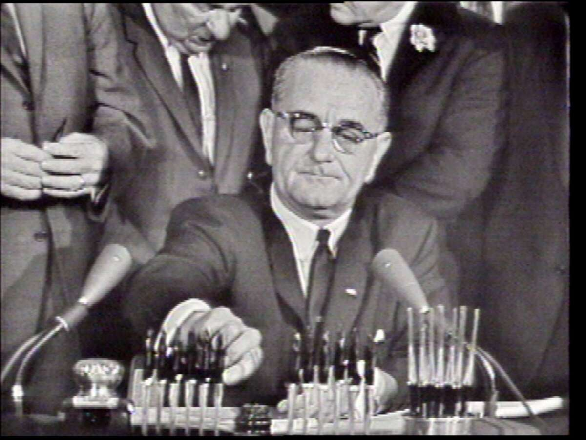 President Lyndon B. Johnson signs the Civil Rights Act on July 2, 1964, in Washington, D.C.